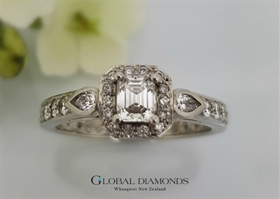 Platinum and Emerald Cut Diamond Cluster Ring