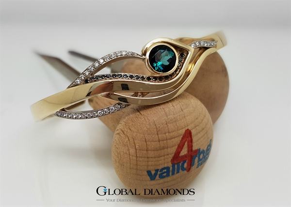 9ct Yellow and White Gold cuff bangle featuring an Indicolite Tourmaline
