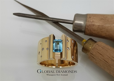 Blue Topaz And Diamonds Yellow Gold Dress Ring