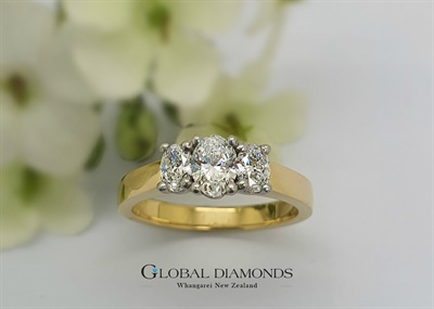18ct Yellow Gold and Platinum Oval Diamond Three Stone Ring