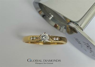 18ct Yellow and White Gold Claw Set Diamond Solitaire Ring with Channel Set Shoulders
